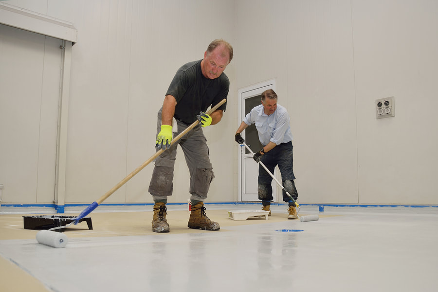 professional painter working on floor painting