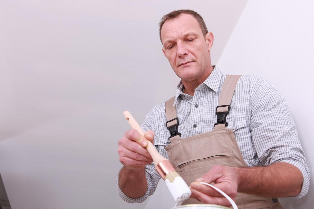 professional painter working on interior painting